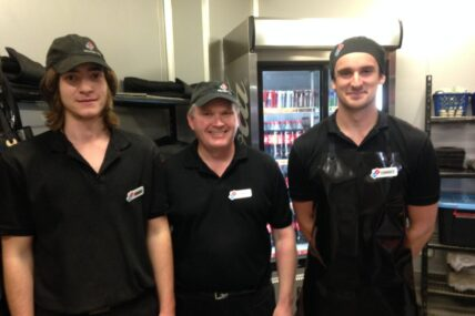 Job seekers in their Domino's Pizza uniforms with new employer