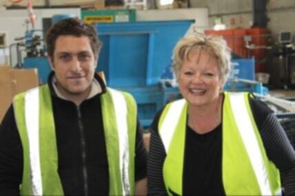 Surplus Recycling Service employer stands next to job seeker in high-vis vests
