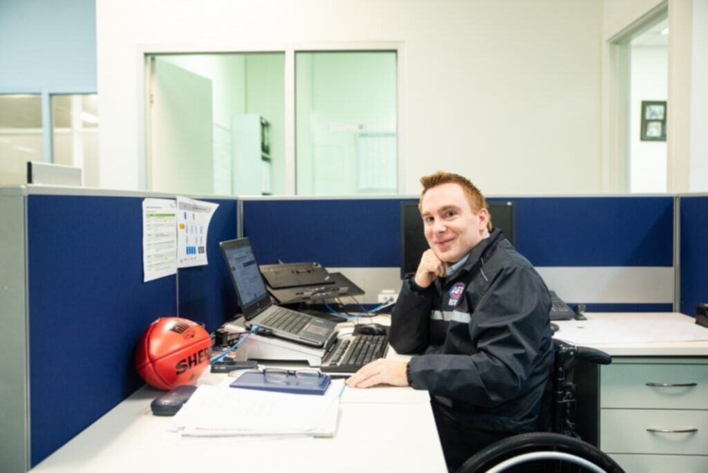 Steve, who has cerebral palsy, is kicking employment goals with AFL Victoria