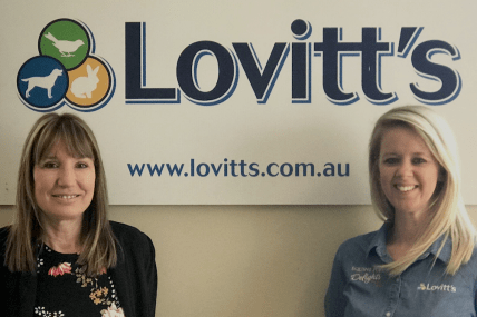 Job Seeker and Employer stand in the Lovitt's office together